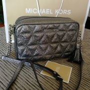 Michael Kors kovově šedá Camera bag crossbody IHNE